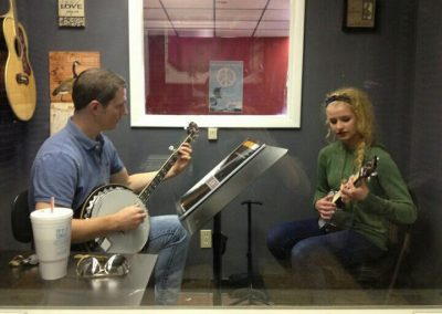 Teacher and student during banjo lessons at Anderson Music Studios.