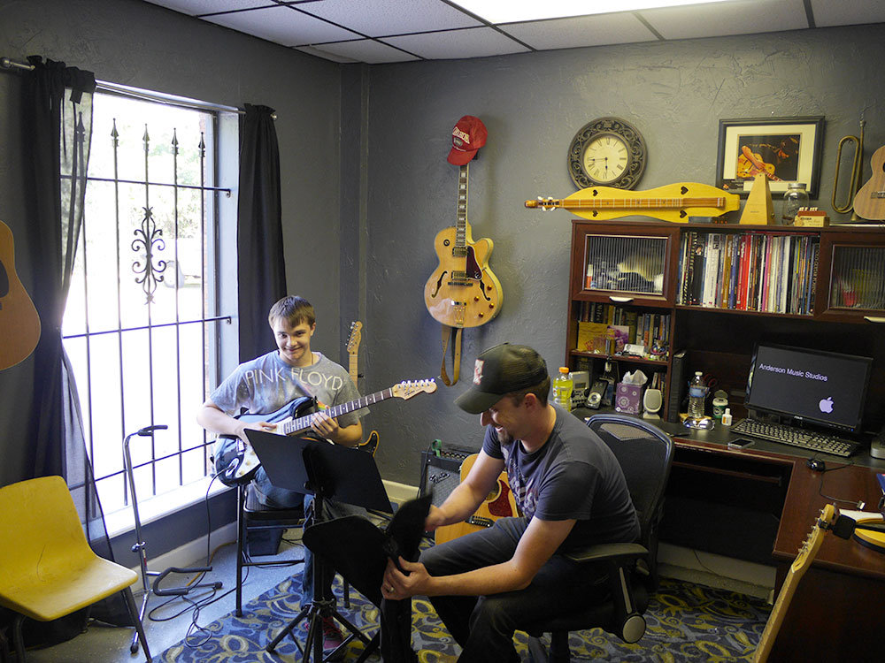 David Anderson teaching guitar lessons in his office at Anderson Music Studios in Oklahoma City.