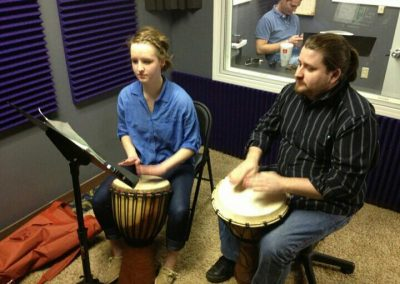 Josh Fallin with a student during drum lessons at Anderson Music Studios.