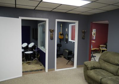 View from the stage area looking at the guitar lesson & drum lesson rooms and parent waiting area Anderson Music Studios.